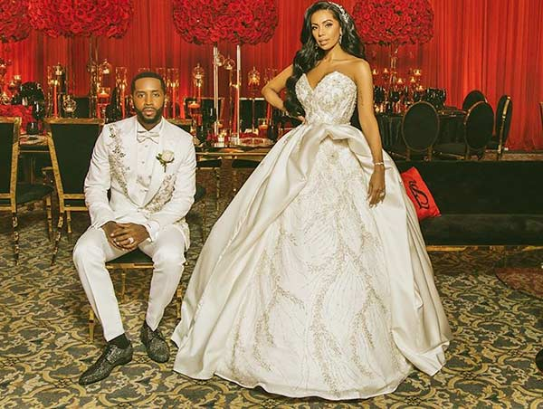 Image of Caption: Erica Mena engaged with her new boyfriend Safaree Samuels