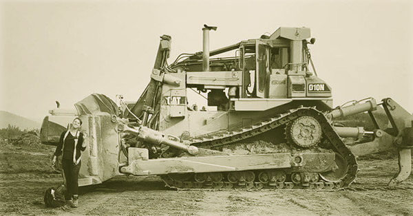 Image of Caption: Ruby Mahoney works heavy equipment in Gold Rush