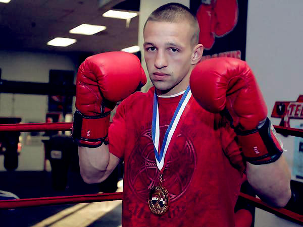 Image of Caption: Jay Paul Molinere while boxing