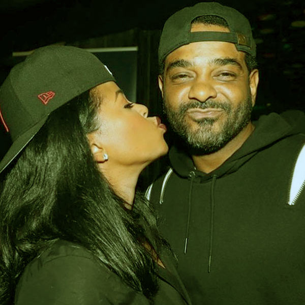 Image of Caption: Chrissy Lampkin with boyfriend-turned-fiancé Jim Jones
