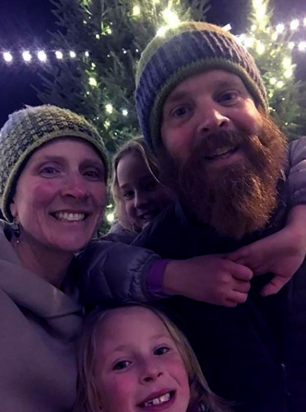 Image of Caption: Chase Morrill with his wife and children