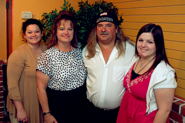 Image of Caption: Bruce Mitchell and his family