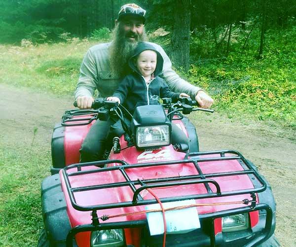 Image of Caption: Matt Raney with his son