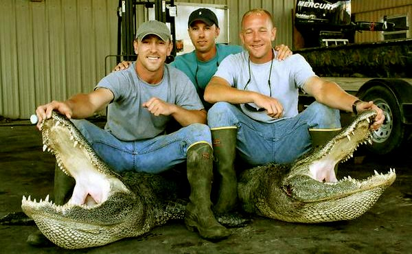 Image of Caption: Chase Landry, his brother Jacob, and his father, Troy Landry