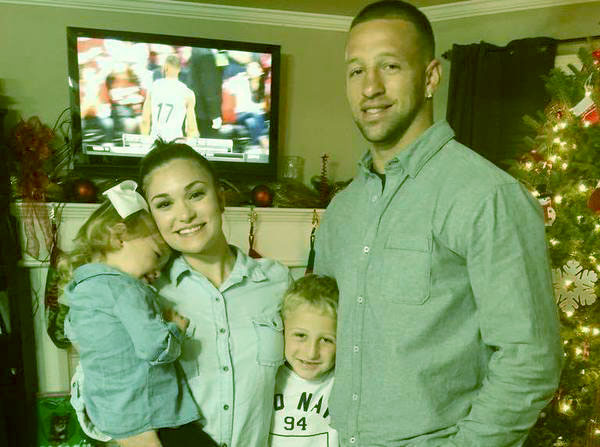 Image of Caption: Jay Paul Molinere, his wife Ashleigh and their two children