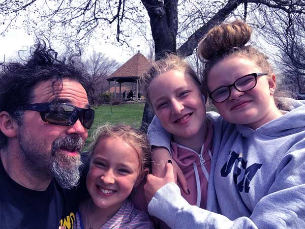Image of Caption: Ryan Eldridge with Chase Morrill's daughters