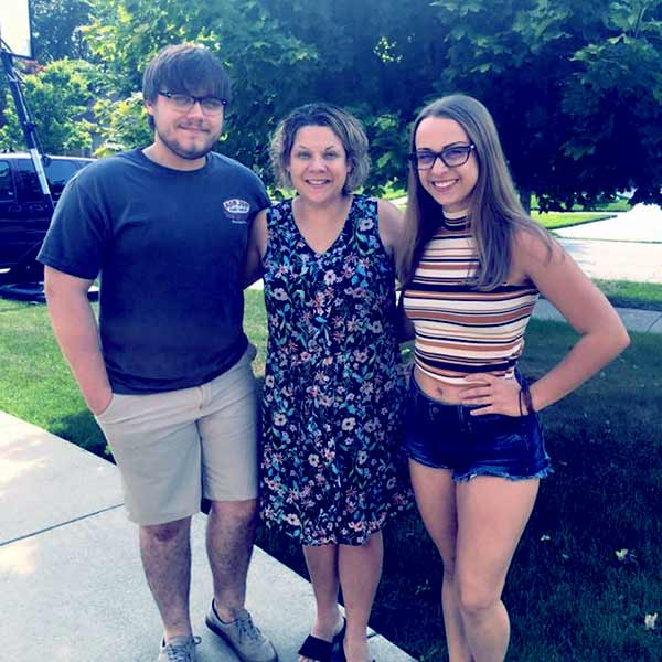 Image of Caption: Kathy Pol with her late son, Adam James Butch and daughter Rachel Butch