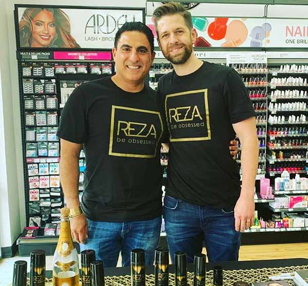 Image of Caption: RezaFarahan with husband Adam