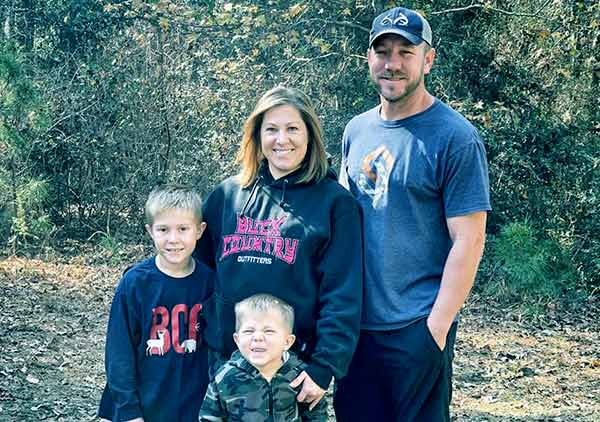 Image of Caption: Jacob Landry, his wife and two sons