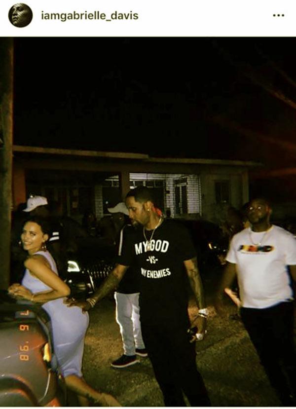 Image of Caption: Safaree Samuels slaps Gabrielle Davis' butt