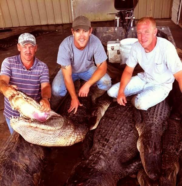 Image of Caption: Troy Landry, Jacob and Chase Landry