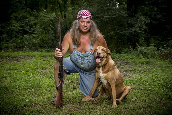 Image of Caption: Bruce Mitchell with his dog, Tyler