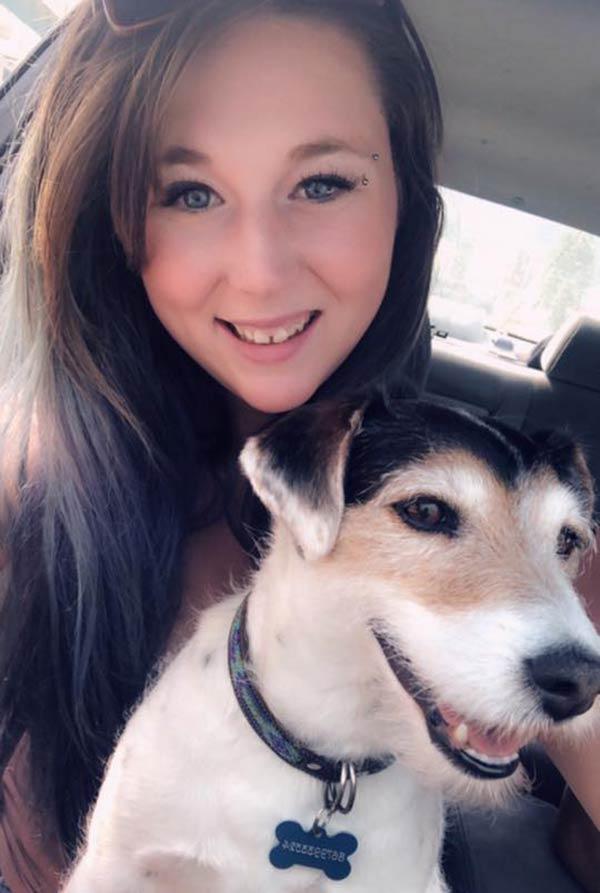 Image of Caption: Ruby Mahoney with her dog, Chela