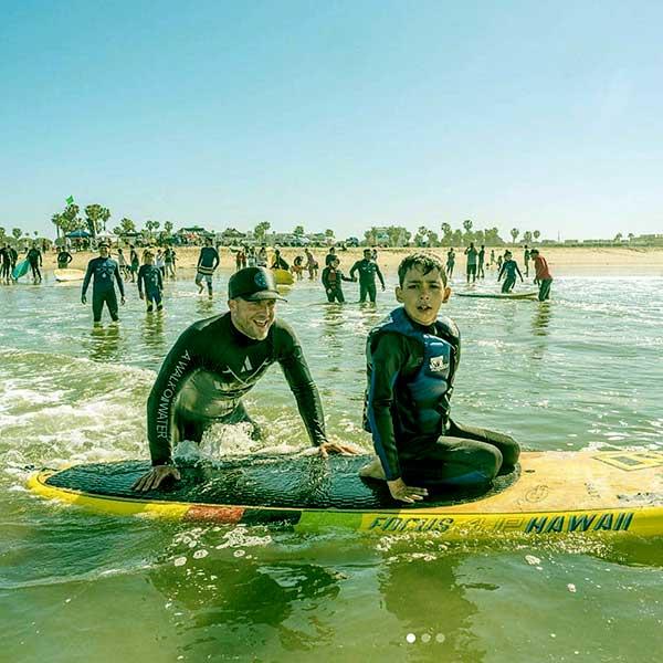 Image of Caption: Adam Teaching Surfing