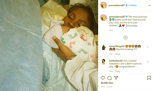 Image of Caption: Premadonna and husband Buck Thomas have a baby daughter