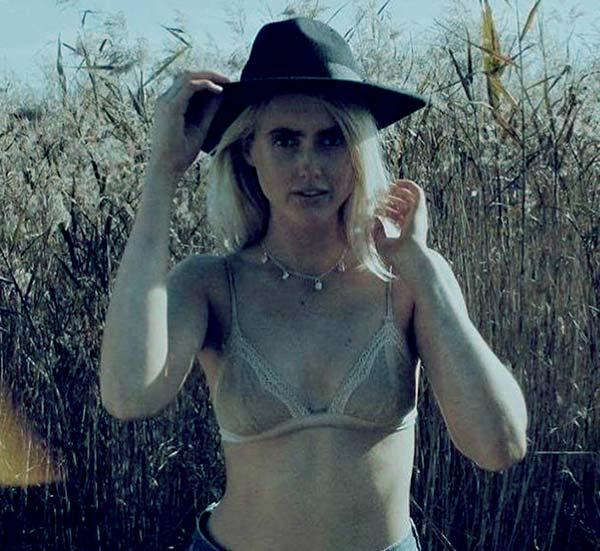 Image of Caption: Tyler Mahoney modeling her swimwear