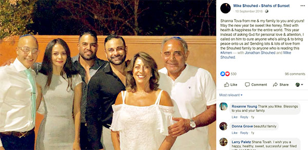 Image of Caption: Mike Shouhed with parents, brother, and family