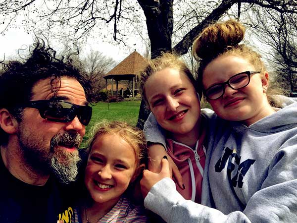 Image of Ashley's husband with Chase Morril's daughters