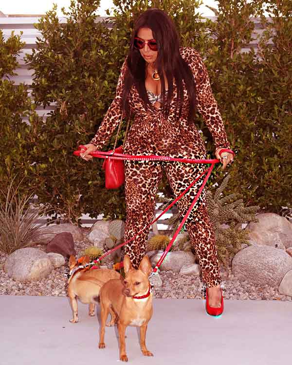 Image of Caption: Mercedes Javid with her dogs Chihuahua Pablo and Julio