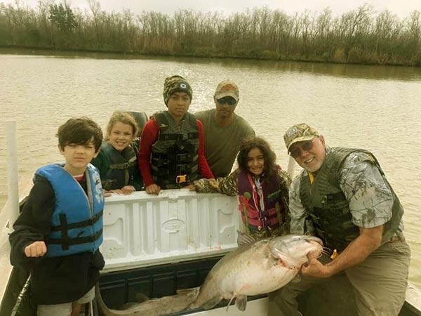 Image of Daniel Edgar with son Joey and his grandchildren