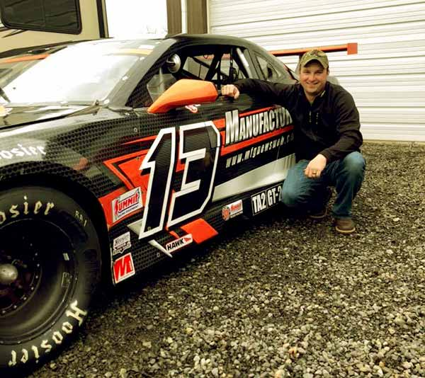 Image of Mitch Blaschke with his racing car