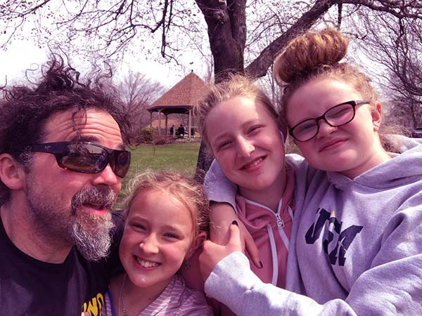 Image of Ryan Eldridge with Chase Morrill's kids