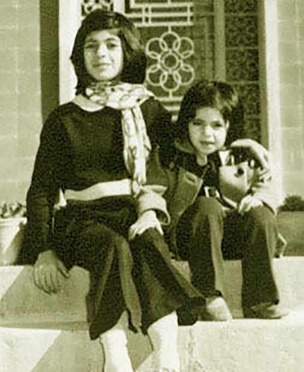 Image of Minoo Rahbar with her older sister, Mitra in Iran